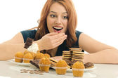 Woman in love with sweets, candies,chocolate and sugar — Stock Photo