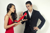Woman happy for her red shoes, woman in love with shopping and asking her boyfriend for permission to buy more shoes — Stock Photo