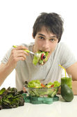 Man eating organic healthy salad for a perfect diet. Green food for a healthy life — Stock Photo