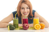 Happy woman holding in front of her three different smoothie. Cheerful young woman eating healthy salad, fruits , orange juice and green smoothie — Stock Photo