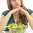 Woman eating organic salad, its hard slimming down with a diet. Woman keeping a diet with green salad — Stock Photo
