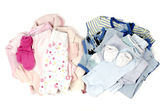 Close up with a blue stack of clean baby clothes for a boy and a pink clean babby clothes for a girl isolated on white — Stock Photo
