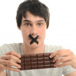 Upset man forbidden from eating a yummy chocolate and having some sugar for an active day — Stock Photo #43441049