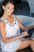 Beautiful brunette businesswoman working on a laptop — Foto de Stock