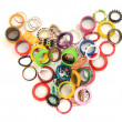 Colorful jewelery in the shape of a heart showing the women's love for accesories — Stock Photo #44285827