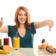 Woman choosing between fruits, smoothie and organic healthy food against sweets, sugar, lots of candies, unhealthy food — Stock Photo #44749751