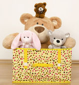 A box full of toys, three bears and a funny rabbit — Stock Photo