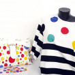 Polka dots and stripes blouse on mannequin with matching accessories. — Stock Photo #47755929