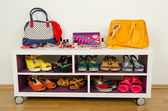 Lots of colorful summer accessories on a shelf. — Stock Photo