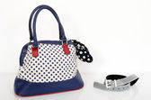 Navy blue polka dots purse and matching accessories. — Stock Photo