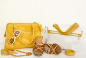 Cute summer yellow bags with matching sandals and accessories. — Stock Photo