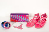 Fucsia sandals with matching accessories. Summer pink sandals with bag and jewellery. — Stock Photo