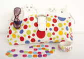 Big colorful polka dots bag with cute matching accessories. — Stock Photo