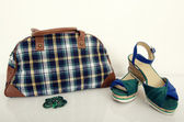 Cute plaid bag with matching sandals. — Stock Photo