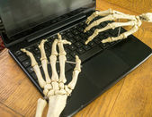 Boney Skeleton Hands Working a Computer — Stock Photo