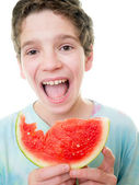 Teen Boy Eating Watermelon — Stock Photo