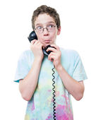 Teen Boy talking on the telephone — Stock Photo