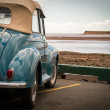 Постер, плакат: Classic Car at the Beach