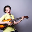 Teenager rocking out with a guitar — Stock Photo #12432004