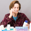 Senior woman managing her medication — Stock Photo