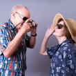 Older couple on vacation taking pictures — Stock Photo