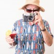 Funny Tourist with Camera and Tropical Drink - Stock Photo