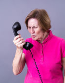 Older Woman Dealing with a rude caller — Stock Photo