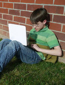 Middle School Student working outside with a computer — Stock Photo