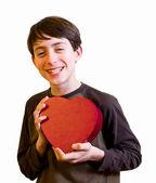 Süsser boy mit valentinstag pralinen — Stockfoto