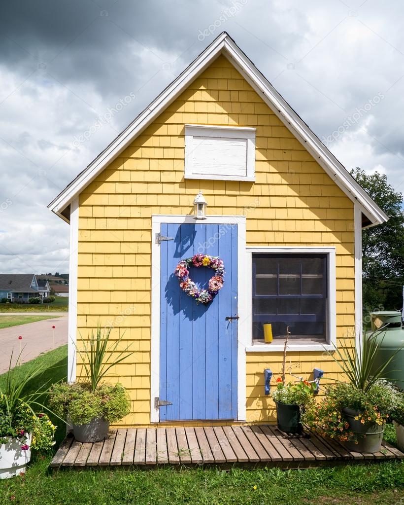 Cute little yellow house stock photo dogfordstudios for Cute house images