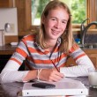 Teenager doing homework after school — Stock Photo