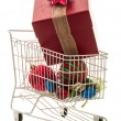 Christmas Shopping Cart with very large gift — Stock Photo #12825040