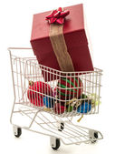 Christmas Shopping Cart with a very large gift — Stock Photo