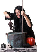 A witch brewing up a spell — Stock Photo