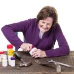 Senior Woman struggling to open her medicine bottle — Stock Photo