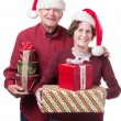 Happy Senior couple bearing gifts at Christmas — Stock Photo