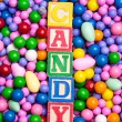 Candy spelled out in alphabet blocks - Stock Photo
