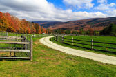 Farm road in the fall — Stock Photo
