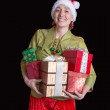 Woman dress in Christmas elf costume with gifts — Stock Photo
