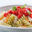 Plate of fusilli with tomato sauce - Stock Photo
