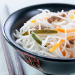 Rice noodles with vegetables, mushrooms and meat — Stock Photo #12208969