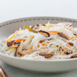 Rice noodles with vegetables, mushrooms and meat — Stock Photo