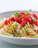 Plate of fusilli with tomato sauce — Stock Photo