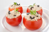 Tomatoes stuffed with tuna and black olives — Stock Photo