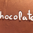 Chocolate written with cocoa powder - Stockfoto
