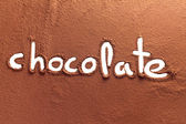 Chocolate written with cocoa powder — Stock Photo