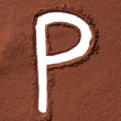 Letter P made of cocoa powder — Stock Photo