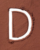 Buchstabe d hergestellt aus kakaopulver — Stockfoto