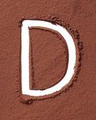 буква d из какао-порошка — Стоковое фото