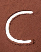 Letter C made of cocoa powder — Stock Photo